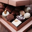 Box filled with chocolates on wooden rustic background — Foto de Stock   #62161791