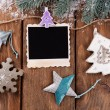 Blank photo frames and Christmas decor with snow fir tree on wooden table background — Stock Photo #62162769
