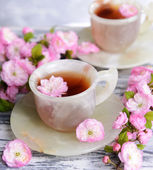 Fruit blossom with tea — Stock Photo