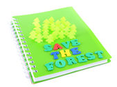 Concept of conservation forests of cut paper on notebook isolated on white — Stock Photo