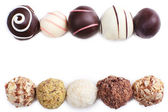 Chocolate truffles lines isolated on white background — Stock Photo