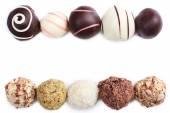 Chocolate truffles lines isolated on white background — Stock Photo