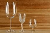 Empty goblets on wooden background — Stock Photo