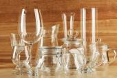 Different glassware on wooden background — Stock Photo