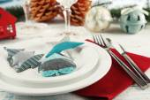 Holiday table setting with Christmas decoration and light background — Stock Photo