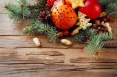 Fruits with cookies, spices and sprigs of Christmas tree on rustic wooden background — 图库照片