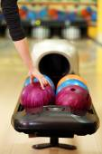 Colorful Bowling balls in ball return — Stock Photo