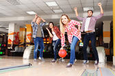 Friends playing in bowling club — Stok fotoğraf