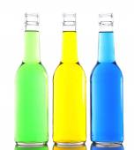 Colorful alcoholic beverages in glass bottles isolated on white — Stock Photo