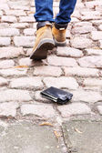 Lost leather wallet and walking male legs, outdoors — Foto Stock