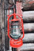 Kerosene lamp on wooden door background — Stock fotografie
