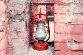 Kerosene lamp on ruined brick wall background — Stock Photo
