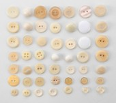 Beige sewing buttons isolated on white — Stock Photo