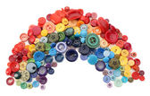 Rainbow of sewing buttons isolated on white — Stock Photo