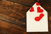 Envelope with hearts — Stock Photo