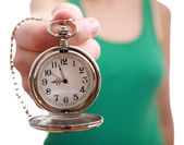 Silver pocket clock in hand close-up — Stock Photo