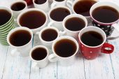 Many cups of tea on table — Stock Photo