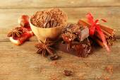 Bowl of cocoa with spices and coffee beans on wooden background — Stock Photo