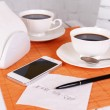 Coffee and phone number on napkin — Stock Photo #62301949