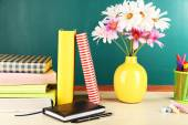Desk with books and flowers — Foto de Stock