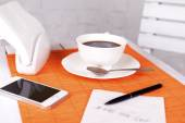 Coffee and phone number on napkin — Stock Photo