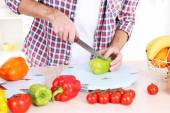 Man cut vegetables in the kitchen — Stock Photo