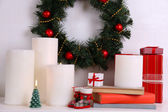 Christmas wreath, candles and presents — Stock Photo