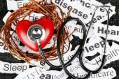 Decorative heart  with stethoscope — Stock Photo