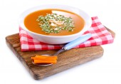 Carrot soup on cutting board isolated on white — 图库照片