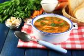 Composition with carrot soup, ingredients and herbs on color wooden background — Stock Photo