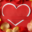 Card with heart and rose petals — Stock Photo #62316633