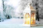 Lantern on wooden surface — Stockfoto