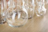 Different glassware on wooden table background — Stock Photo