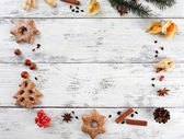 Christmas pine sprig with spices and cookies — Stock Photo