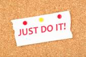 """Motivating paper sheet with inscription """"Just do it"""" on wooden background — Stock Photo"""