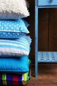 Hill of colorful pillows — Stock Photo