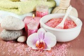 Spa treatments with orchid flower on wooden table on colorful background — Stock Photo