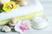 Spa treatments with orchid flowers on wooden table background — Stock Photo