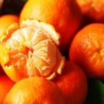 Fresh ripe mandarins in wicker basket, close-up — Stock Photo #62484031