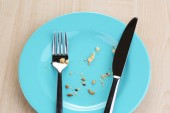 Plate with crumbs on wooden background  — Stock Photo