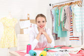 Young dressmaker in workroom — Stock Photo