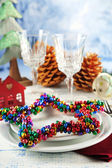 Holiday table setting with Christmas decoration and light background — Stockfoto