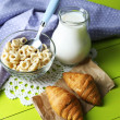 Homemade yogurt and delicious cereals in bowl on wooden table background. Conceptual photo of healthy and tasty breakfast — Stock Photo #62560335