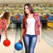Young women holding bowling ball in club — Stock Photo #62561833