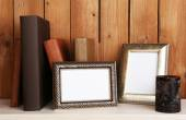 Frames with candle and books — Stock Photo