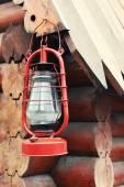 Kerosene lamp hanging on wooden house, outdoors — Stock Photo