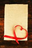 Paper with ribbon in heart shape — Stock Photo