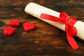 Rolled paper with hearts — Stock Photo