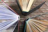 Group of books on wooden planks background, top view — 图库照片