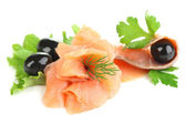 Sliced and rolled salmon, black olive and herbs isolated on white — Stock Photo
